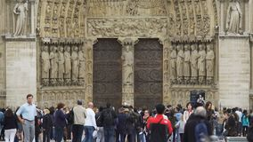 Group of tourists walking near Notre Dame de Paris, sightseeing in France stock video footage