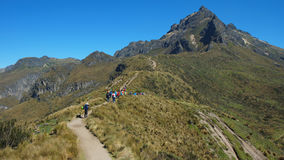 Group of tourists walking towards the Rucu Pichincha near the city of Quito Royalty Free Stock Photos
