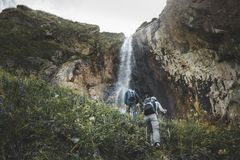 Group Of tourists Walking Uphill To Waterfall. Travel Adventure Outdoor Concept stock photos
