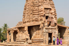 Group of tourists watching the towers of ancient Hindu temple Stock Photography