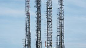 Group of towers for telecommunications, television broadcast, cellphone, radio and satellite on Linzone mountain peak. Telecommunication center stock footage