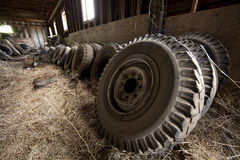 Group of tractor tires. A group of tractor tires leaning against the barn wall Stock Photography