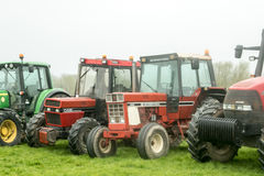 A group of tractors parked up Royalty Free Stock Photography