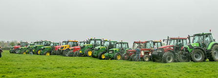 A group of tractors parked up Royalty Free Stock Images