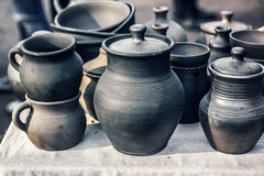 Group of traditional handmade pottery for sale at the market. Ukrainian handmade earthenware utensil. Souvenirs From Ukraine Royalty Free Stock Images
