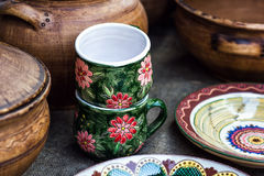 Group of traditional handmade pottery for sale at the market. Ukrainian handmade earthenware utensil. Souvenirs From Ukraine Stock Photos