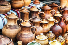 Group of traditional handmade pottery for sale at the market. Ukrainian handmade earthenware utensil. Souvenirs From Ukraine Royalty Free Stock Photos