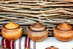 Group of traditional handmade pottery for sale at the market. Ukrainian handmade earthenware utensil. Souvenirs From Ukraine Royalty Free Stock Photography