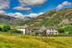 A group of traditional whitwashed cottages in the English Lake District. royalty free stock image