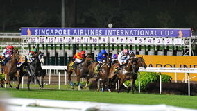 Group trailing behind Military Attack during Singapore Airlines International Cup 2013 Stock Image
