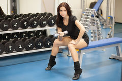 Slim woman training in a gym Royalty Free Stock Photo