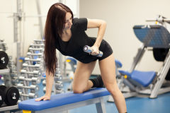 Slim woman training in a gym Royalty Free Stock Photography