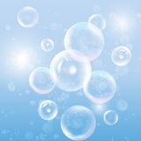 Group of transparent spheres on blue background. Group of transparent spheres on a blue background vector Royalty Free Stock Images