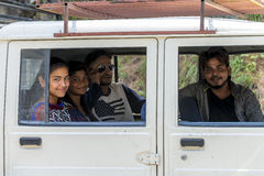 Group of travel companions sit inside vehicle having an enjoyable moment, Himachal Pradesh. Royalty Free Stock Photos