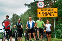 Group of travelers cyclists, road sign pointer, Belarus, Grodno, August 2017. Road sign pointer, group of travelers cyclists, Belarus, Grodno, August 2017 Stock Photography