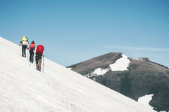 Group Travelers hiking in mountains glacier Royalty Free Stock Images