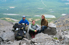 Group of travelers in mountains with knapsacks Royalty Free Stock Photo