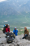 Group of travelers in mountains with knapsacks Royalty Free Stock Images
