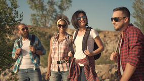 Group of travelers talking on nature stock image