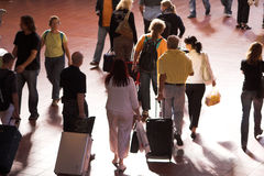 Group of traveller. Rushing through departure hall,strong backlight,slight motionblur Royalty Free Stock Images