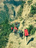 Group of trekkers on Annapurna circuit in Nepal. Royalty Free Stock Images