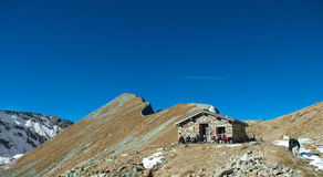 Group of trekkers rest in a hut Stock Photography