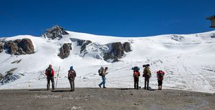 Group of trekkers standing in front of the Plateau Rosa in Val D`Aosta, Italy. royalty free stock image