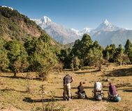 A group of trekkers in watching panorama of Mount Machapuchare Fishtail, Poonhill circuit, Annapurna circuit. Himalayas, Nepal. Sunny morning stock image