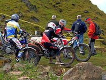 Group of trial motorcycle riders with audience Royalty Free Stock Photo