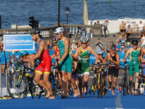 Group of triathletes parking cycles in the transition zone Stock Photography