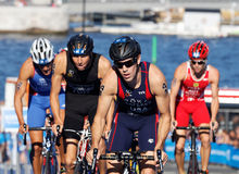 Group of triathlon competitors cycling uphill Royalty Free Stock Photography
