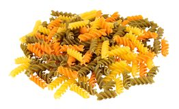 Group Of Tricolore Fusilli Pasta Twists. Group of uncooked tricolore fusilli pasta twist shapes isolated on a white background royalty free stock photography