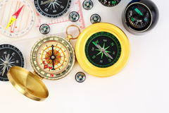Group of twelve small and big compasses Stock Photos