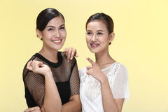 Group of Two Asian Smile Women in black and lace white dress fas Stock Image
