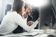 Group of two business person at working process.Young professionals work with new market project. People using computer stock photography