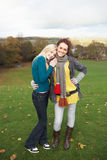 Group Of Two Teenage Female Friends. In Autumn Landscape Stock Photos