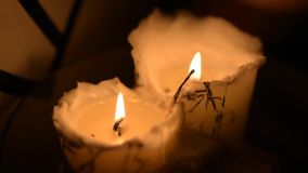 Group of two wax candles burning. With bright yellow light stock video footage