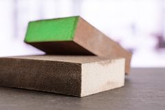 Work tool item in the office. Group of two whole work item green and grey abrasive block sponges in the office stock photography