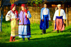 Group of ukrainian people walking the village after folk festivities Stock Photography
