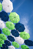 Group of umbrellas against blue sky Royalty Free Stock Images