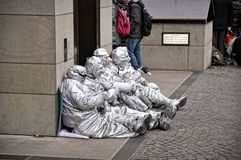 A group of unidentified busking mimes street performers in silver paint, Cologne, Germany Royalty Free Stock Photos