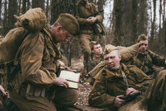 Group of unidentified re-enactors dressed as Royalty Free Stock Photo