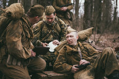 Group of unidentified re-enactors dressed as Stock Image