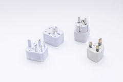 Group of universal plugs adapters. Stock Photo