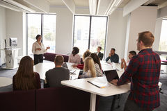 Group Of University Students Attending Lecture On Campus royalty free stock photos