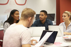 Group Of University Students Collaborating On Project Royalty Free Stock Photos