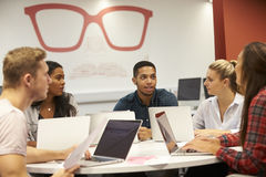 Group Of University Students Collaborating On Project Stock Images