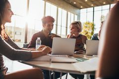 Group of university students doing research on internet Royalty Free Stock Photography