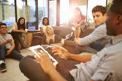 Group Of University Students Relaxing In Common Room Stock Photography