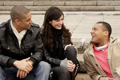 Group of university students sitting on steps Royalty Free Stock Photo